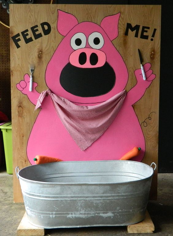 Pig Bean Bag Toss with bean bag carrots to toss through mouth and metal tub to catch carrots that don't make it through.