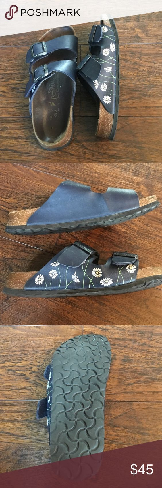 Navy Papillio by Birkenstock Arizonas Papillio by Birkenstock Arizona sandals. The design is navy with daisies on the outside. They are in good used condition with good treads {shown in pic}. They are a size 38 (US 7.5/8) Birkenstock Shoes Sandals