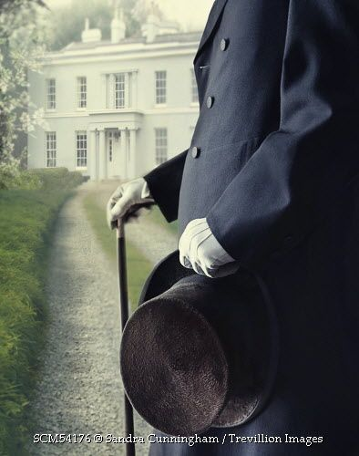 Trevillion Images - closeup-of-a-gentleman-waering-top-hat-and-cane