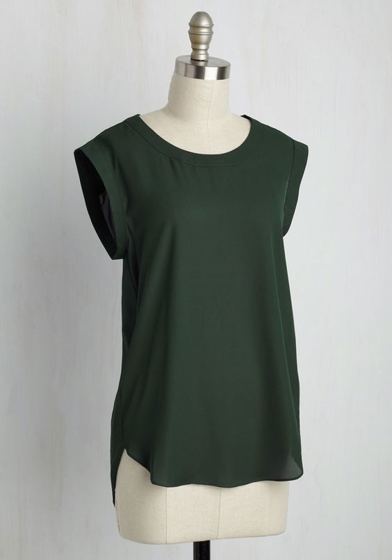 Go Through the Promotions Top. Is it just us, or is this green tops best accessory the glow of success? #green #modcloth