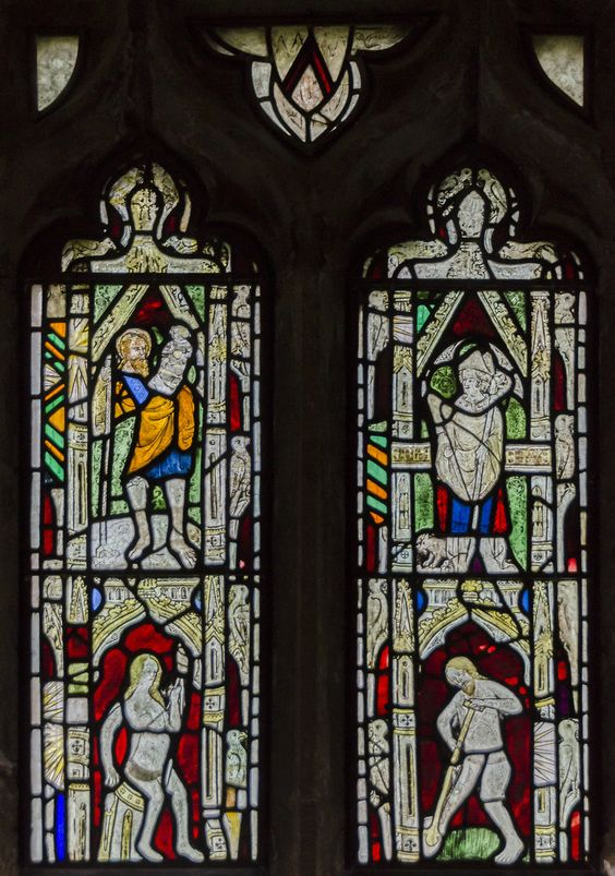 https://flic.kr/p/ANUCrW | Medieval glass, St Michael's church, Halam, Notts. | This window is located on the north side of the chancel, and consists of glass dating from the 14th century. The left light shows Saint Christopher at the top with the Christ Child on his shoulder. Eve is depicted below and sits on a stool spinning with a distaff and shuttle. The right-hand light has, at the top, St Blaise with a Crozier. The right-hand is lost. At his feet is a pig, probably related to the legen...: