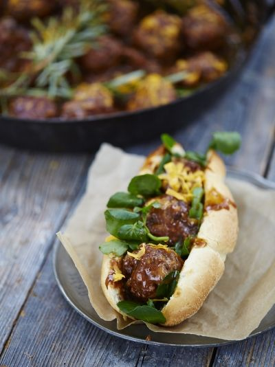 """Mega meatball sub """"This gorgeous comfort food dish is quick and easy – warm subs, loaded with juicy meatballs and melted cheese, and served with a show-stopping gravy for ultimate dunking. """""""