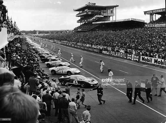 Drivers wearing helmets run to their cars after the commencement of the 24 Hour Le Mans Auto race, France, June 18, 1966.