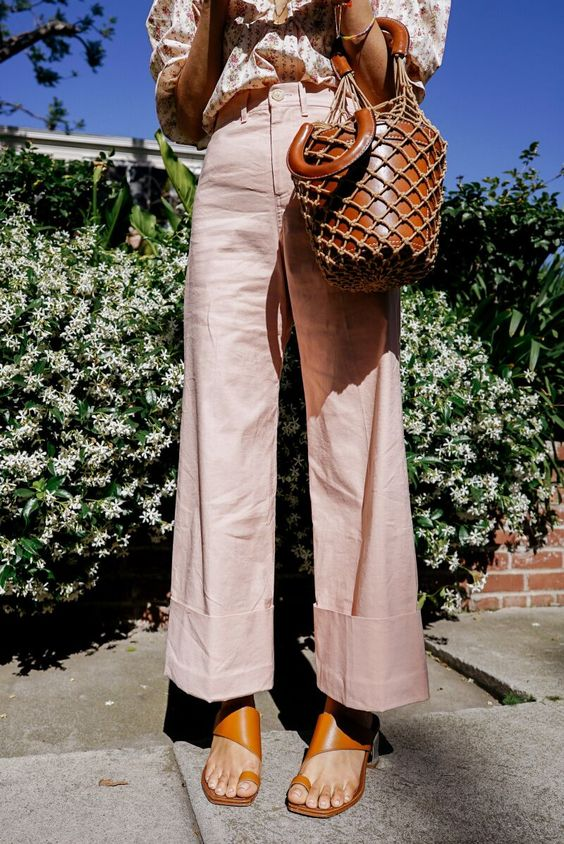 Aimee Song, fashion blogger of Song of Style, feels pretty in pink and you can too in a Petersyn blouse, Sea NY pants, and Sigerson Morrison sandals.