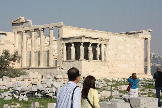 This smaller temple is the Erechtheum.  Those women holding it up compose the Porch of Caryatids.