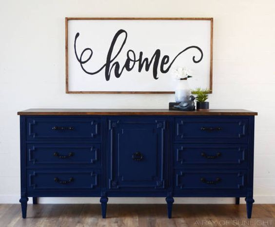 This sleek deep navy blue media console features 7 dovetailed drawers, 2 shelves, rubbed bronze hardware and a dark walnut farmhouse top. What a statement! The door is perfect to hide electronics when needed. The custom finish was sprayed on for a smooth even finish, lightly distressed and sealed for extra durability. Would be great as an entryway table, dresser, dining room buffet, or changing table.  Measures: 72 long x 18 deep x 32.5 tall Located in Tucson, Az  LOCAL PICKUP: Free local pic...