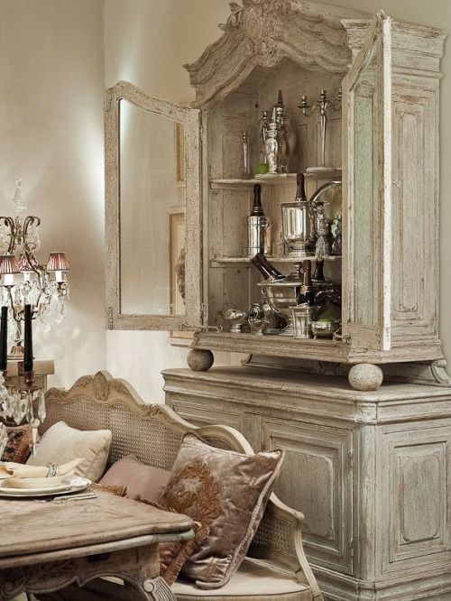 Like the old hutch and how they have redone it...the colors and the French Country look.. French country