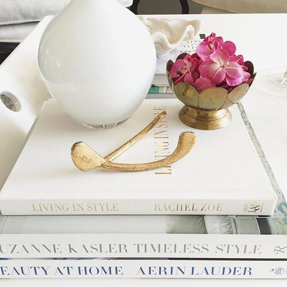 Coffee table styling. Wishbone from @thecrossdesign. #ellivenstudioathome #crossdesign #homegoodshappy #smploves #myoklstyle #myhousebeautiful #decor #styling #myhomesense:
