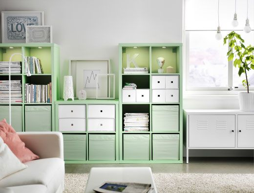 Living room storage with KALLAX shelving combination in mint green, RIBBA frames and a KARLSTAD sofa bed in white