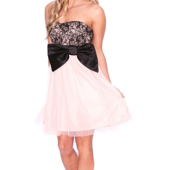Prom dress. Special occasion dress. Medium. NWT. NWT. Medium. In this sweet little dress, you truly will be styled to perfection! Wear it with classy heels and pretty bracelets for a night to remember! Features a zipper closure on the back.  100% Polyester Dresses