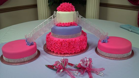 Hot pink, lilac and White - Quinceanera cake with stair case to side cakes.    Follow me on Facebook:   Casa de Cakes in Arizona.    Thank youl
