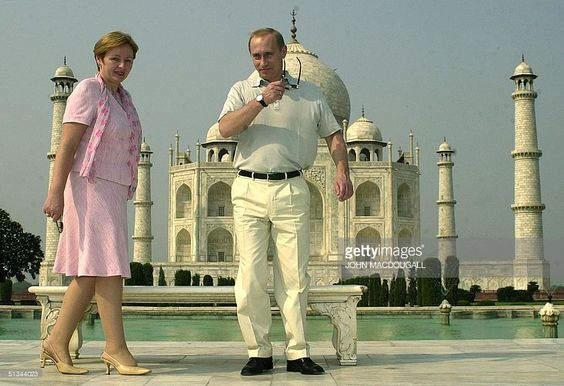 Russian President Vladimir Putin takes his sunglasses off before posing with his wife Lyudmila in front of the Taj Mahal 04 October 2000. Putin is on a three-day visit to India.
