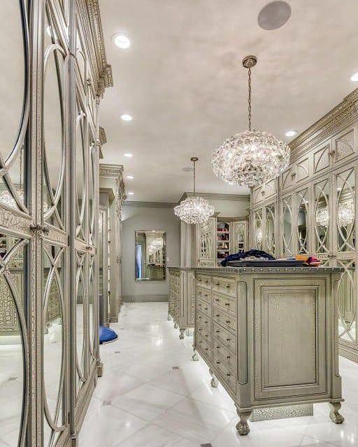 Luxurious walk-in closet with mirror and metal cabinet doors #mirror #closet #storage #organization #allenrothCloset #allenAndRothCloset #closetShelves