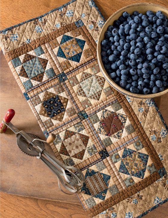 Another delish sneak peek from Simple Friendships, the new book by Kim Diehl and Jo Morton. This is Jo's Blueberry Buckle quilt - such a blue-and-brown beauty!: