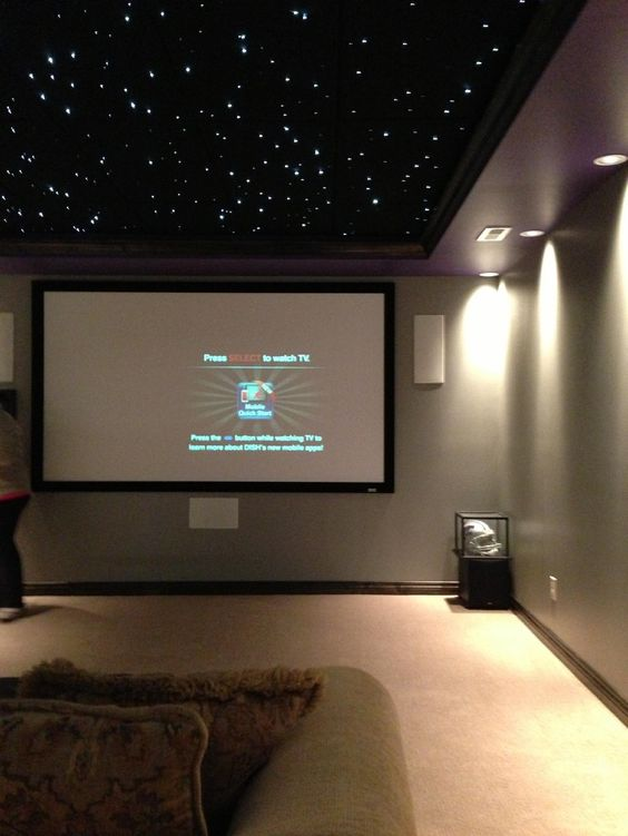 basement media room with black ceiling