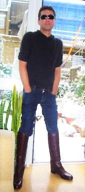 Skinny kid in jeans and tall boots.