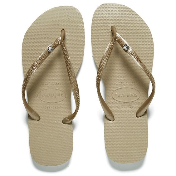 Havaianas Women's Slim Crystal Glamour Sw Flip Flops - Sand Grey/Soft... ($47) ❤ liked on Polyvore featuring shoes, sandals, flip flops, beige, crystal flip flops, strappy thong sandals, havaianas flip flops, strap sandals and toe thongs