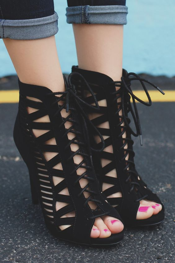 Peep toe, faux suede, stiletto heels with cutout design, lace up front and a zipper back