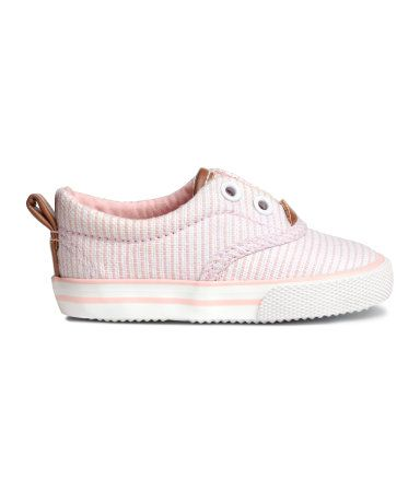 Cotton sneakers with imitation leather details, concealed elastication at top, and cotton lining. Rubber soles.