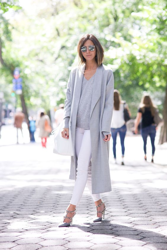 Blogger Style | Arielle Noa Charnas (Something Navy): grey extra-long coat x grey sweater x white skinny jeans x valentino rockstud heels