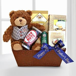 Celebrate Dad this Father's Day with a handsome faux leather container full of tasty goodies.  http://www.facebook.com/Dfwflowers  http://www.dfwflowers.com/