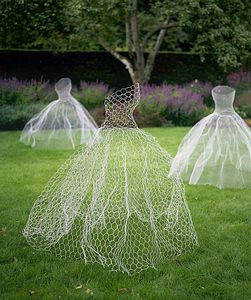 Ghost Dresses made from chicken wire. A sheet of chicken wire cut and shape the torso around a willing female (carefully) and cut to this shape. It should just stand freely as the wire will keep it in place. Take it a step further and spray paint with glow in the dark paint (pretty sweet idea for October). That would be freaky at night.