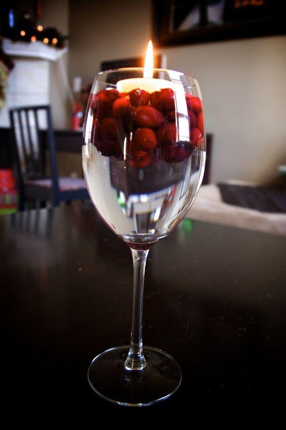 Wine glass floating cranberry candle holder cut up lemon slices or