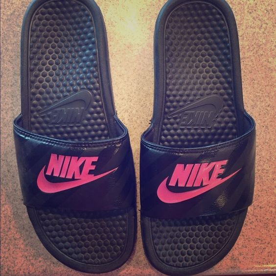 Nike Benassi Sandals I am selling a pair of women size 9 Nike Benassi sandals. They have only been worn a couple times. They are black with pink writing. Perfect for wearing with socks! Nike Shoes Sandals