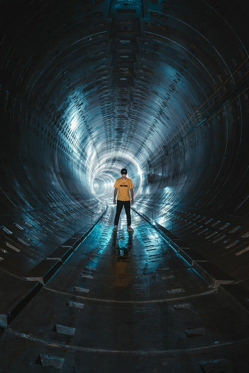 Low Light Photography Of Man Standing Inside Tunnel Light Photography Low Light Photography Long Exposure Light Photography Low light hd wallpaper download