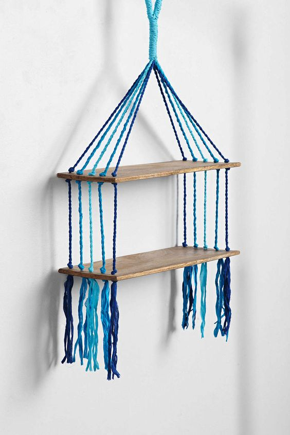 Magical Thinking Woven Hanging Shelf - urban outfitters. they have a few different macrame shelves that i really love.: