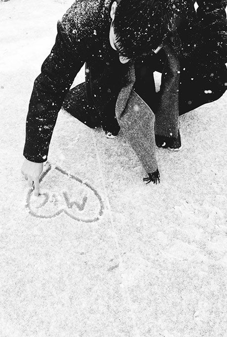 Brides.com: . Take advantage of snowy sidewalks and write your initials in a heart, like this sweet groom did.: