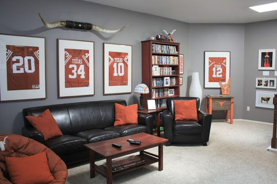 Classy Man Cave: Texas Longhorn-Themed Game Room Décor.  Framed retired Texas football jerseys, dark leather, burnt orang accents, and cherrywood stained furniture. Click or visit FabEveryday.com for all the details on how to style your own chic (not tacky) man cave!
