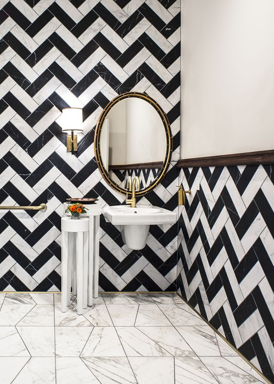 black and white chevron tile design / powder room // via @formlosangeles