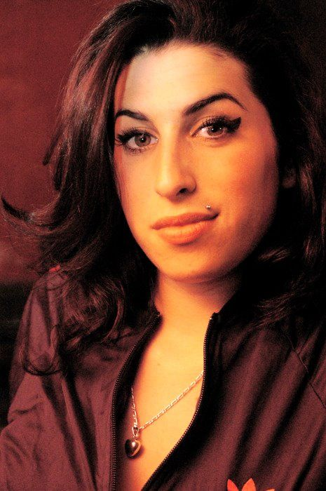 Amy Winehouse...that smirk turns me on/off, just as she'd Love it,--accompanied by her Music/Poetry (per movie 'Amy')
