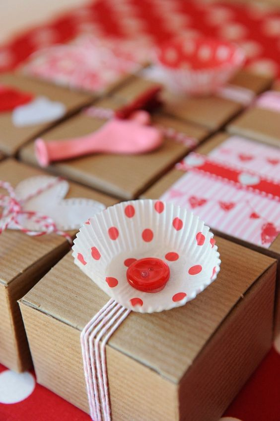 Gift wrapping with cupcake liners! Be My Valentine Party with SUCH CUTE Ideas via Kara's Party Ideas Kara Allen KarasPartyIdeas.com #BeMine #ValentinesDayParty #PartyIdeas #Supplies