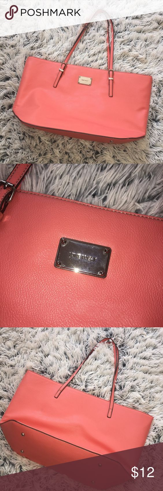 Nine West purse Very spacious, it's more of a peachy color. Nine West Bags