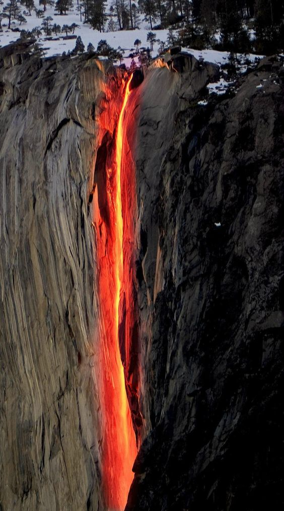 """""""Horsetail Fall in California flows only in winter and spring. Most days of its 'life' this fall has a regular color. But every February, just for a couple of days, this fall turns into the fire. Lit by the sun, Horsetail Fall reflects orange and red rays."""""""