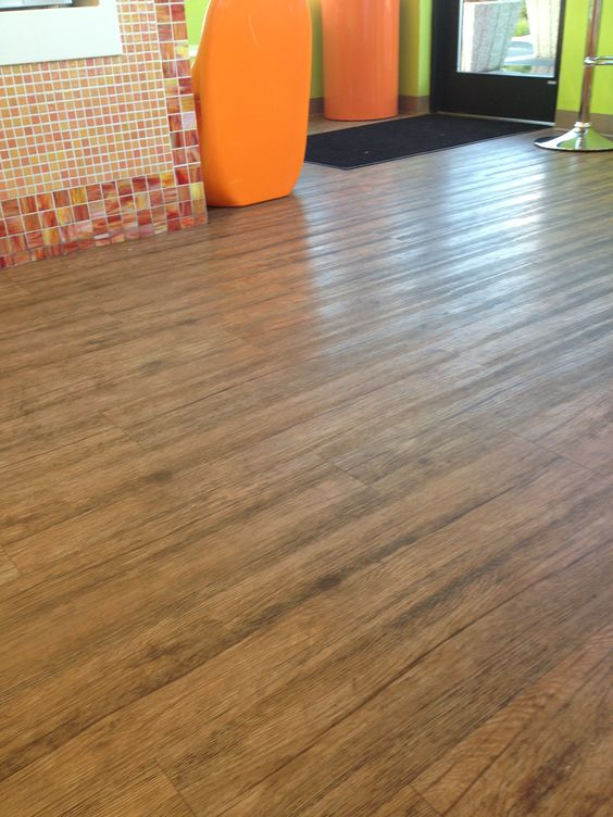 Flooring thick rubber laminate vct looks like hard wood for Rubber laminate flooring