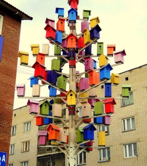 colorful tree of birdhouses
