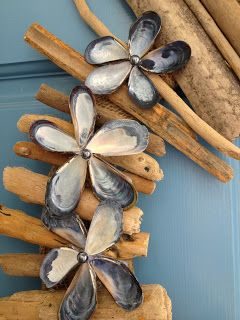 Driftwood and mussel shell flower wreath....gorgeous.