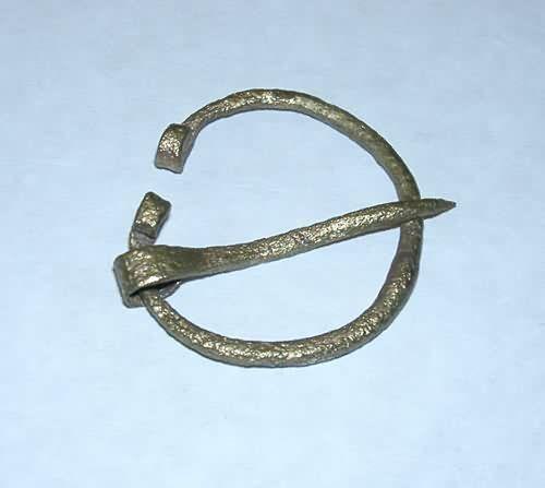 Horseshoe brooch spiralekonechnaya XI-XII centuries. Bronze. Detail of the ancient costume. Found on Earthen mound, Staraya Ladoga. Staraya Ladoga Museum.