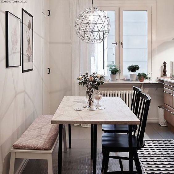 Love the light fixture and seating styles. How to style a small dining space - like the bench and chairs and chandelier