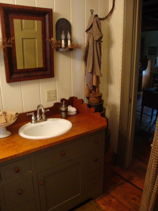 bathroom with painted paneling...