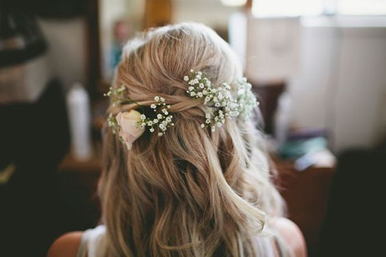 Baby's breath adds a dose of charm to an otherwise simple twisted half-up style.
