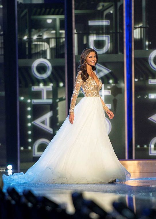 6. Miss Oklahoma 2015 – Georgia Frazier   Georgia was hands down the gown of Miss America this year. In a sea of colored taffeta and other thicker fabrics, when she walked in on this (almost literal) cloud, it took my breath away.  Read more: http://thepageantplanet.com/top-10-pageant-gowns-of-2015/#ixzz3xoM70fdS