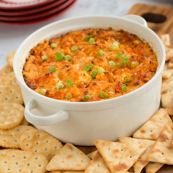 FRANK'S RedHot Buffalo Chicken Dip 2 cups shredded cooked chicken     1 (8 oz. pkg.) cream cheese, softened     1/2 cup FRANK'S® RedHot® Original Cayenne Pepper Sauce or FRANK'S RedHot® Buffalo Wings Sauce     1/2 cup blue cheese or ranch dressing     1/2 cup crumbled bleu cheese or your favorite shredded cheese