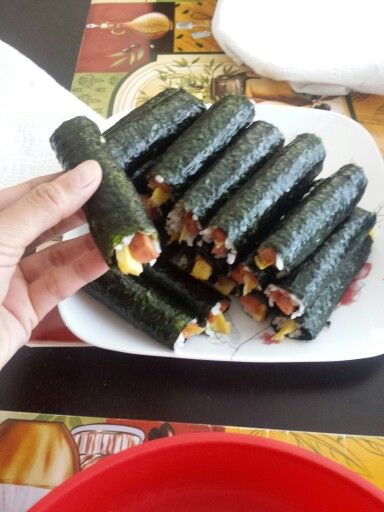 Homemade mini spam musubi roll instead of the typical ones. Just cut up spam and fried egg lengthwise. Fry spam with soy sauce/sugar mixture then roll