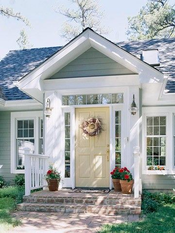 I love this entry. Since when did garages become the focal point of houses. I hate a big garage up front with a small door beside/behind the garage. Whatever happend to entryways and functional porches?!