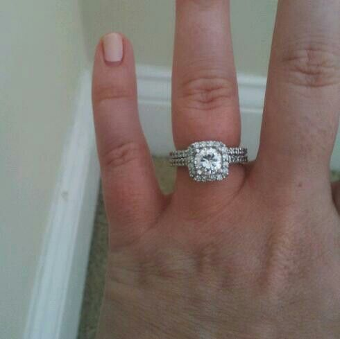 My platinum engagement ring & wedding band: cushion cut band with round center stone From Cole Jewelry