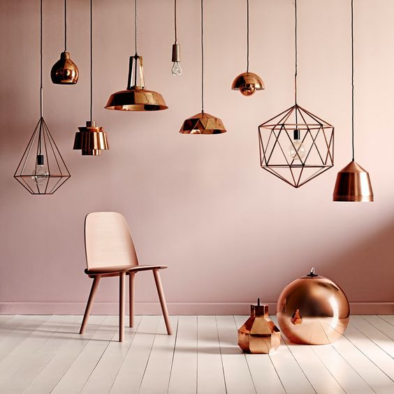 Tom Dixon lamp + peach wall + copper accents + white wood floors. http://www.calversandsuvdal.com